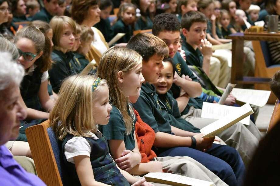 Children  from St. Thomas the Apostle School attend a mass where fourth graders dressed as saints during All Saints Day at St. Thomas the Apostle Church on Thursday, Nov. 1, 2018 in Delmar, N.Y. (Lori Van Buren/Times Union) Photo: Lori Van Buren / 40045349A