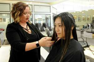 Blessy Maris has her hair done by Stefani Cutler at Visible Changes in Memorial City Mall Wednesday Sept.26, 2018.