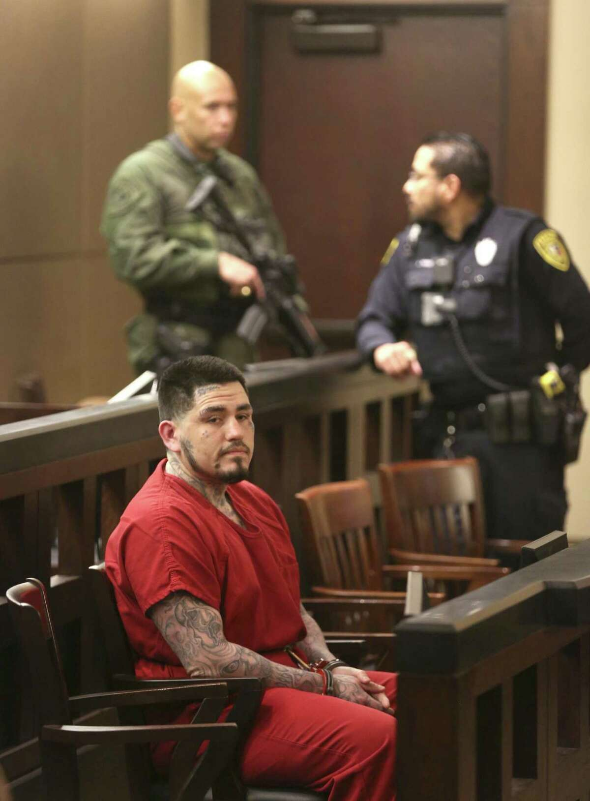 Daniel Moreno Lopez, convicted of beating a man to death, dismembering his body and burning his limbs on a barbecue pit, sits under heavy guard Thursday, Nov. 1, 2018 in the 379th state District Court in the Cadena-Reeves Criminal Justice Center during the second day of his sentencing trial.