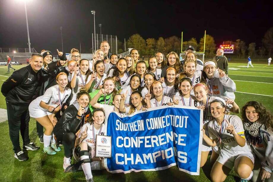 The Shelton girls soccer team celebrates its win in the SCC championship game against Mercy on Thursday. Photo: John Vanacore / For Hearst Connectucit Media / (c)John H.Vanacore