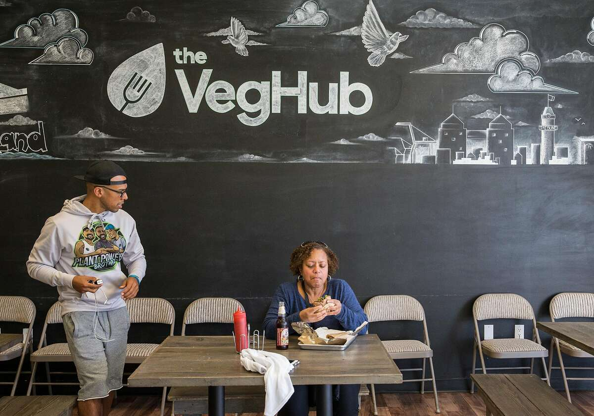 Customers enjoy plant-based lunches while dining at The Veg Hub in Oakland, Calif. Wednesday, Oct. 31, 2018.