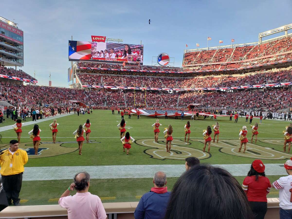 A San Francisco 49ers cheerleader kneeled during the national anthem ahead of Thursday night's home game against the Oakland Raiders.