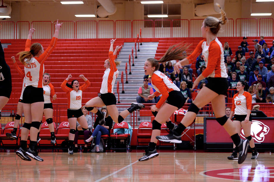 Orangefield players celebrate winning a set against Anderson-Shiro during a Class 3A area playoff volleyball game at Crosby High School on Thursday night.   Photo taken Thursday 11/1/18  Ryan Pelham/The Enterprise Photo: Ryan Pelham, The Enterprise / ©2018 The Beaumont Enterprise