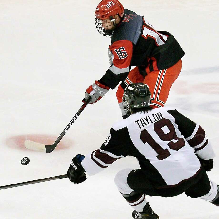 RPI's #16 Jacob Hayhurst, top, gets past Union's #19 Brendan Taylor during Friday night's game Oct. 26, 2018 in Troy, NY.  (John Carl D'Annibale/Times Union) Photo: John Carl D'Annibale / 20045247A