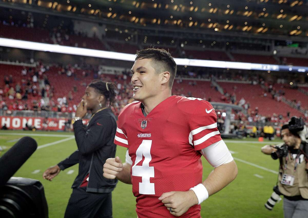 Nick Mullen (4) smiles as he runs off the field after getting his first NFL win after the San Francisco 49ers defeated the Oakland Raiders 34-3 at Levi's Stadium in Santa Clara, Calif., on Thursday, November 1, 2018.