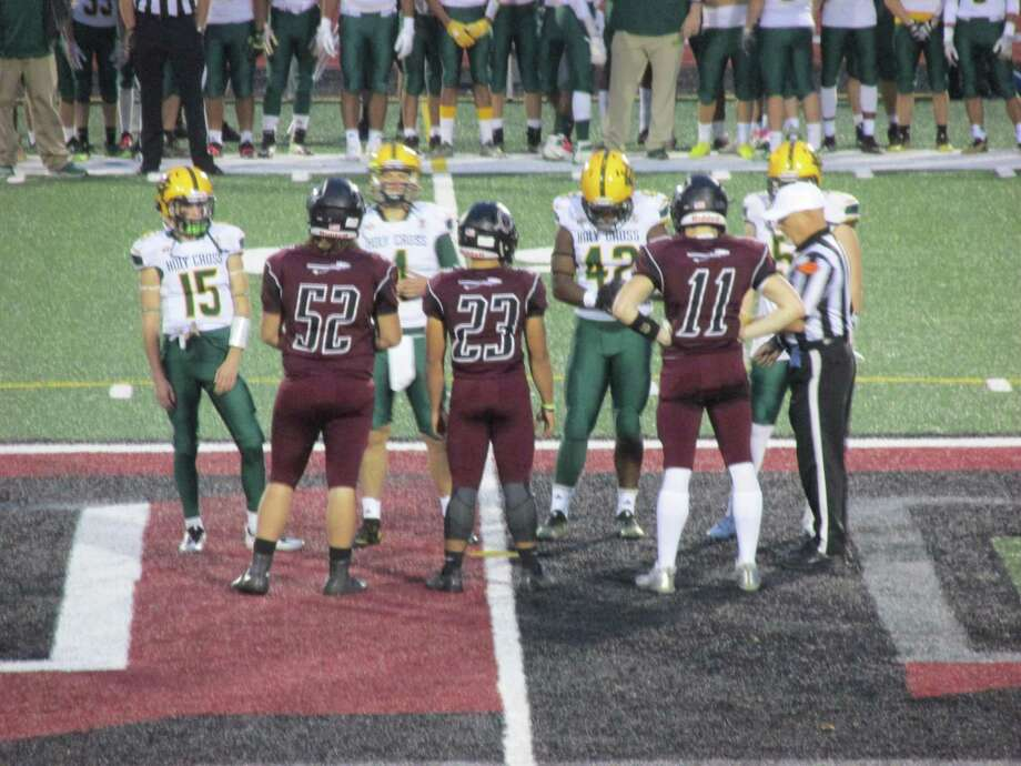 Holy Cross and Torrington line up for the coin toss prior to an NVL football game on Thursday. Photo: Contributed Photo / Greenwich Time Contributed