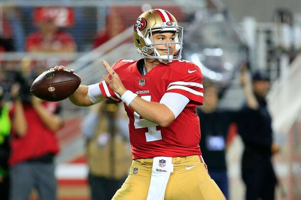 SANTA CLARA, CA - NOVEMBER 01: Nick Mullens #4 of the San Francisco 49ers looks to pass against the Oakland Raiders during their NFL game at Levi's Stadium on November 1, 2018 in Santa Clara, California. (Photo by Daniel Shirey/Getty Images)