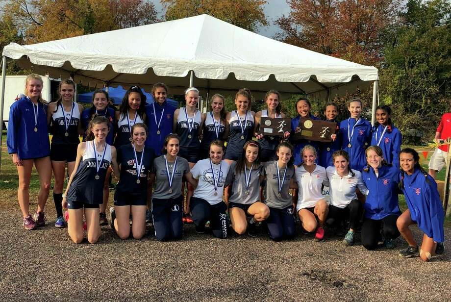 The Danbury girls cross country team edged Immaculate by one point for the State Open title Photo: Marsha Turek /Contributed Photo