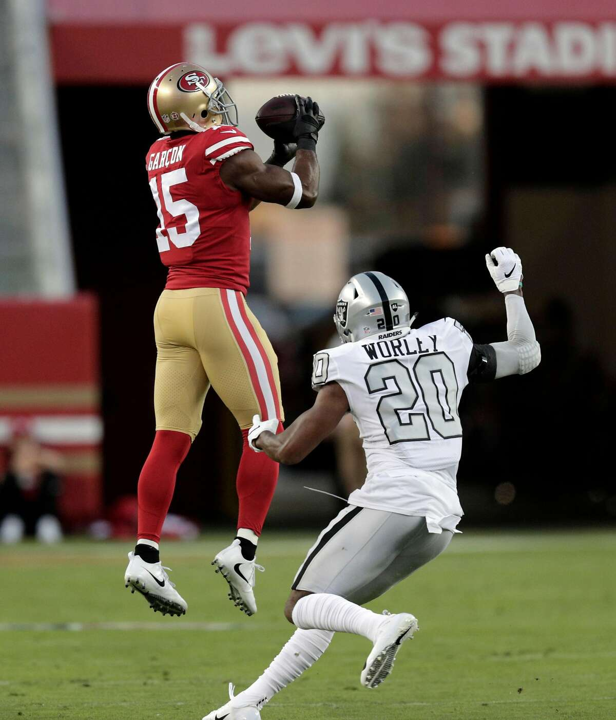 Pierre Garcon (15) leaps for a catch from Nick Mullens (4) in the first quarter as the San Francisco 49ers played the Oakland Raiders at Levi's Stadium in Santa Clara, Calif., on Thursday, November 1, 2018.
