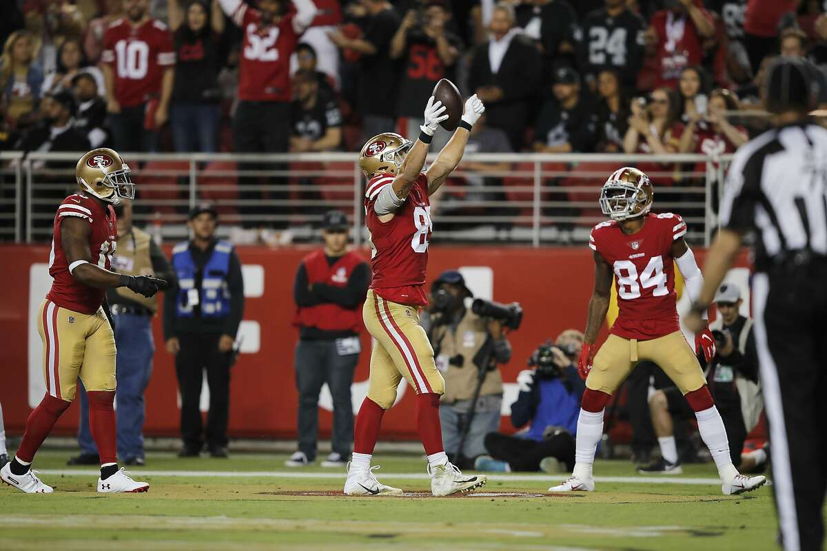 San Francisco 49ers tight end George Kittle, left, celebrates next to wide receiver Kendrick Bourne after scoring against the Oakland Raiders during the second half of an NFL football game in Santa Clara, Calif., Thursday, Nov. 1, 2018. (AP Photo/John Hefti)