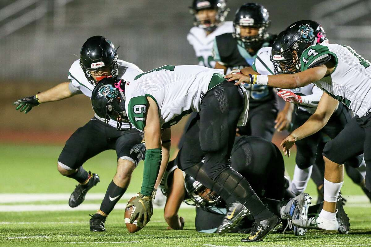 Southwest's Jesse Hernandez picks up a Harlan fumble during the second half of their District 14-5A-I high school football game at Gustafson Stadium on Thursday, Nov. 1, 2018.