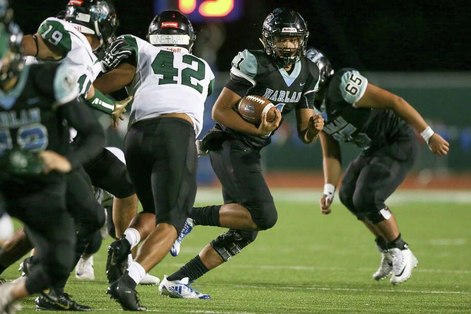 Quarterback Kannon Williams is 60 of 95 for 975 yards with 13 TDs and three interceptions for unbeaten Harlan. Photo: Marvin Pfeiffer /Staff Photographer / Express-News 2018