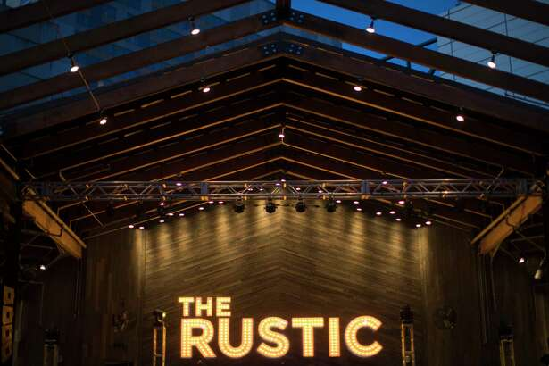 The Rustic giant letter shine during the opening of the restaurant which also has a music stage and a bar, Thursday, Nov. 1, 2018, in Houston.