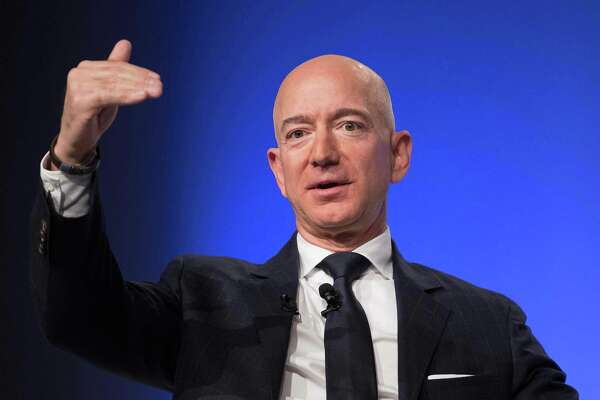 (FILES) In this file photo taken on September 19, 2018 Amazon and Blue Origin founder Jeff Bezos provides the keynote address at the Air Force Association's Annual Air, Space & Cyber Conference in Oxen Hill, Maryland. - Online retail giant Amazon announced on October 2, 2018 it would raise its starting wage for US workers to $15 an hour, amid long-standing criticism of low pay, and advocate for a higher minimum wage nationwide.The pay raise will apply to 250,000 employees, starting November 1, and to the more than 100,000 seasonal workers the company expects to hire for the holiday shopping season. (Photo by Jim WATSON / AFP)JIM WATSON/AFP/Getty Images