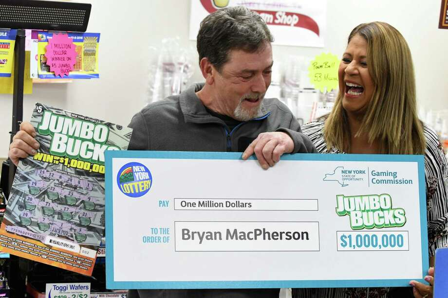 What would it be like to stand next to Yolanda Vega announcing you won a big Lottery prize? Click through for some Capital Region people who know the answer.    Bryan MacPherson or Porter Corners is presented with a lottery check by Yolanda Vega of the New York Lottery at the South Broadway Stewart's on Thursday, Nov. 1 2018, in Saratoga Springs, N.Y. MacPherson won $1 million on a scratch-off ticket. He opted to take the one-time lump sum payment of $537,440 (Will Waldron/Times Union) Photo: Will Waldron, Albany Times Union / 40045364A