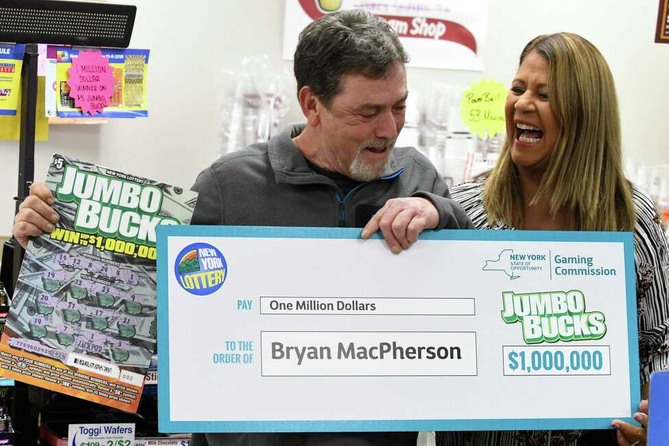 What would it be like to stand next to Yolanda Vega announcing you won a big Lottery prize? Click through for some Capital Region people who know the answer.  Bryan MacPherson or Porter Corners is presented with a lottery check by Yolanda Vega of the New York Lottery at the South Broadway Stewart's on Thursday, Nov. 1 2018, in Saratoga Springs, N.Y. MacPherson won $1 million on a scratch-off ticket. He opted to take the one-time lump sum payment of $537,440 (Will Waldron/Times Union)
