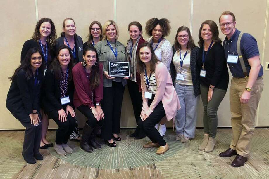 "Dr. Traci Schluter (holding plaque), the CFISD Psychological Services Department director, and members of the department pose after they were named the 2018 recipient of the ""Outstanding Delivery of School Psychological Services"" district award by the Texas Association of School Psychologists on Oct. 25 at the association's 26th Annual Professional Development Convention in Dallas. Photo: CFISD"