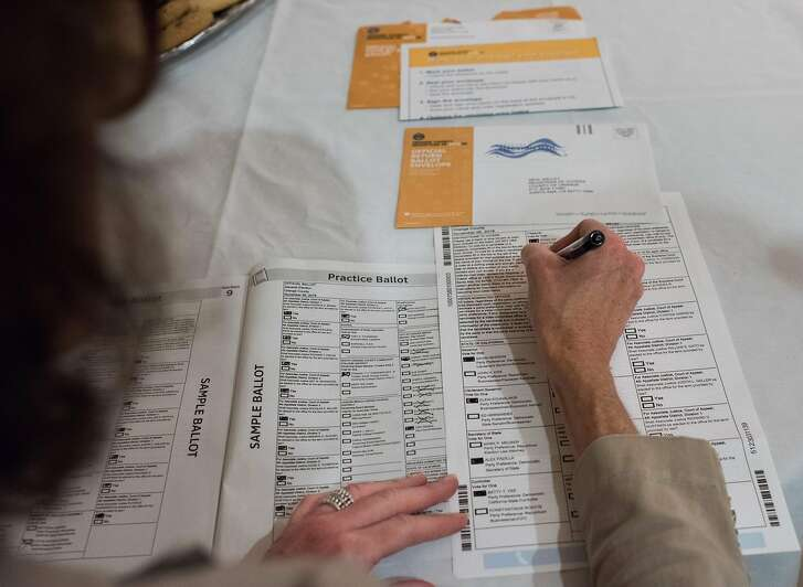 Voter Becky Visconti completes her mail-in ballot at a Ballot Party at a private residence in Laguna Niguel, in Orange County California, October 24, 2018. - In their effort to take back control of the US Congress, Democrats are hoping to flip red Republican seats to Democrat blue in seven fiercely competitive contests in California in the upcoming November 6th midterm election. (Photo by Robyn Beck / AFP)ROBYN BECK/AFP/Getty Images