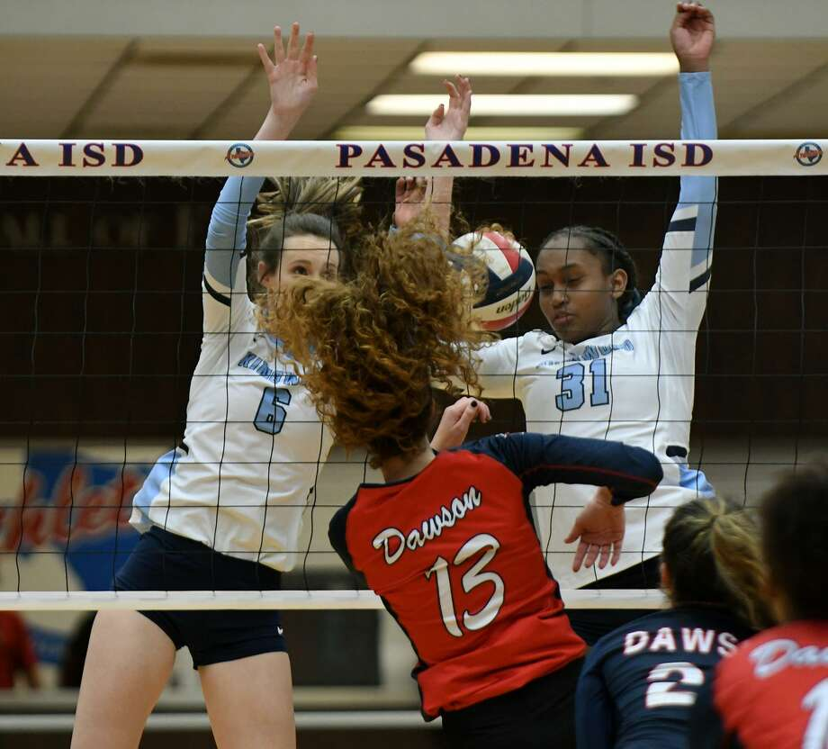 Kingwood senior middle blocker Camden Gray (6) and junior outside hitter Breanna Burrell (31) can't complete the block Thursday against Pearland Dawson junior middle blocker Nikki Deslatte (13) during the third set of their UIL Region III Class 6A Area Volleyball Playoff at Phillips Fieldhouse in Pasadena. Photo: Jerry Baker, Houston Chronicle / Contributor / Houston Chronicle