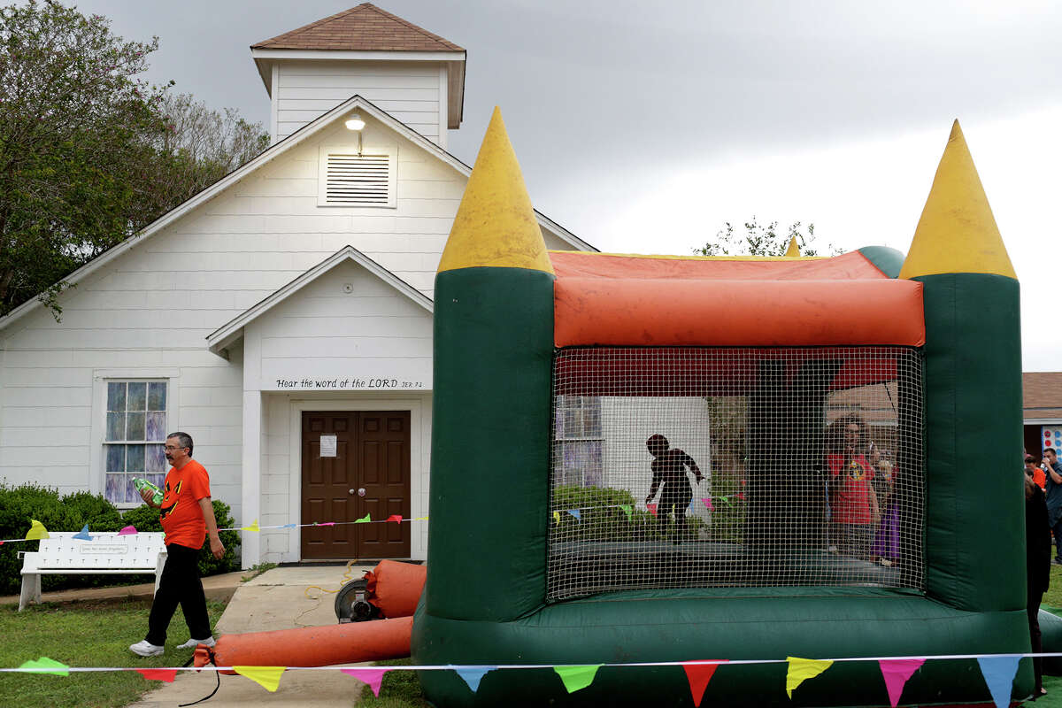 Children play in a bounce house during Fall Fest at First Baptist Church of Sutherland Springs on Oct. 31, 2018.