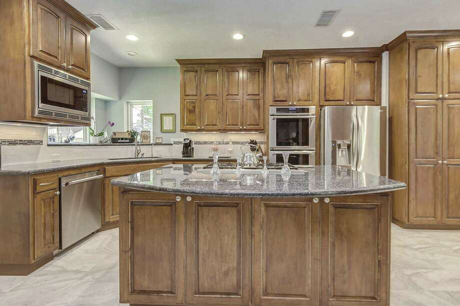 Custom cabinets accommodate your preferred appliances.