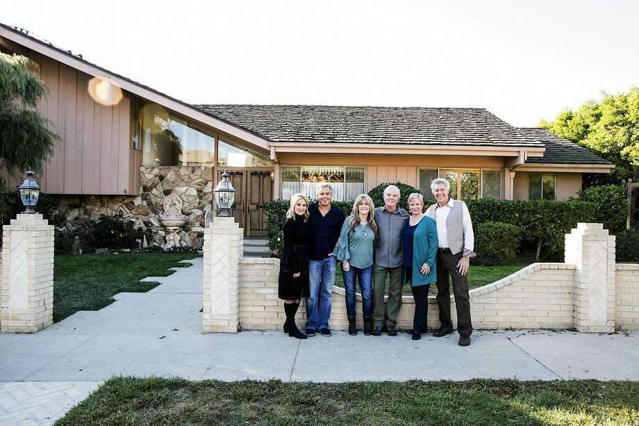 "In this Thursday, Nov. 1 2018, photo provided by HGTV,  members of the ""The Brady Bunch"" cast from left to right, Maureen McCormack, Christopher Knight,  Susan Olsen, Mike Lookinland, Eve Plumb and Barry Williams pose in front of the original Brady home in the Studio City neighborhood in Los Angeles. The cast members gathered Thursday at the home that was featured in the opening and closing of the sitcom. HGTV purchased the home in the Studio City neighborhood in Los Angeles for its new series, ""A Very Brady Renovation.""  HGTV plans to expand the home without compromising its street view and reimagine the show's interior design.  The program is set to premiere in September 2019. Photo: Associated Press"