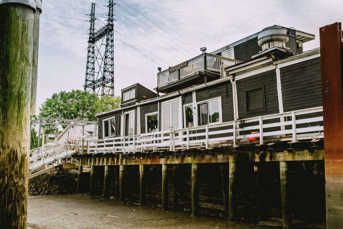 The river side of the Black Duck Cafe, which is a converted 1840s barge, in Westport, CT,