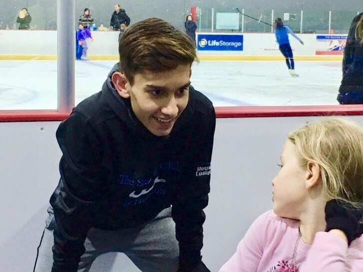 Daniel Argueta chats with Nichole Kline, one of the aspiring figures skaters he coaches in his spare time.