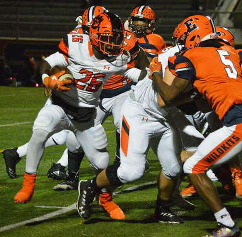 Edwardsville running back Justin Johnson tries to find room behind his offensive line against the Evanston defense in the first round. Photo: Matt Kamp/Intelligencer