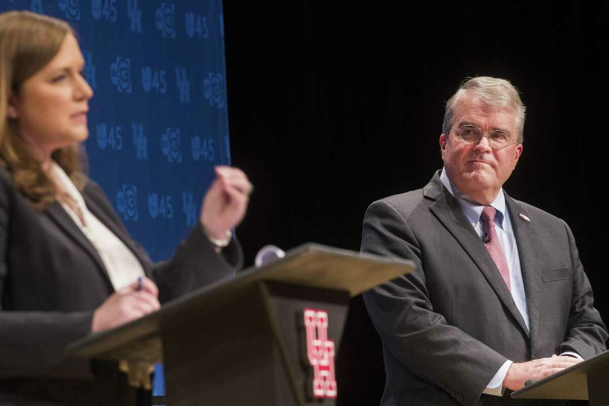 Republican U.S. Rep. John Culberson (TX-07) observes his opponent Democrat Lizzie Pannill Fletcher as she speaks about her platform during a debate at the University of Houston, Sunday, Oct. 21, 2018, in Houston.
