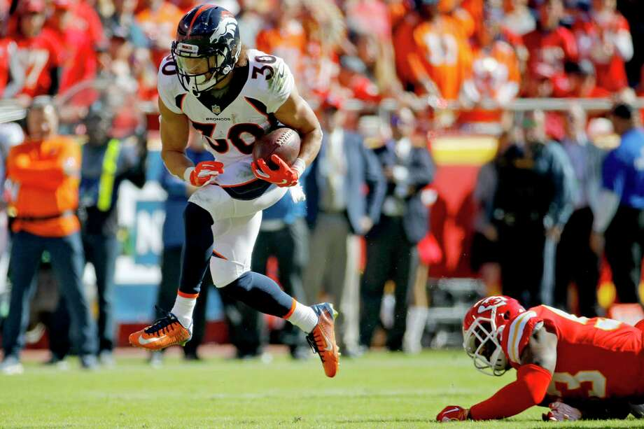 PHOTOS: John McClain's 2018 Week 9 predictions  Denver Broncos running back Phillip Lindsay (30) survives a tackle attempt by Kansas City Chiefs linebacker Anthony Hitchens (53) during the first half of an NFL football game in Kansas City, Mo., Sunday, Oct. 28, 2018. (AP Photo/Charlie Riedel)  >>>See The General's picks for Week 9 of NFL action ...  Photo: Charlie Riedel, Associated Press / Copyright 2018 The Associated Press. All rights reserved