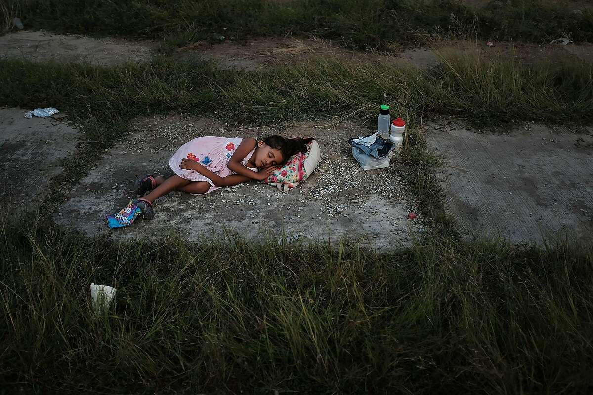 A child sleeps as members of the Central American caravan settle in for the night in a abandoned motel on Nov. 01, 2018, in Matias Romero Avendando, Mexico. The group of migrants, many of them fleeing violence in their home countries, took a rest day on Wednesday and resumed their march towards the United States border on Thursday.