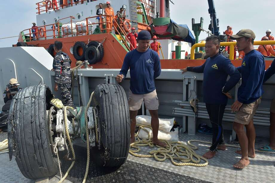 Navy divers look at the wheels of the ill-fated Lion Air plane, which were recovered from the Java Sea. Other parts of the crashed jet were also hauled from the sea. All 189 people on board were killed. Photo: Adek Berry / AFP / Getty Images