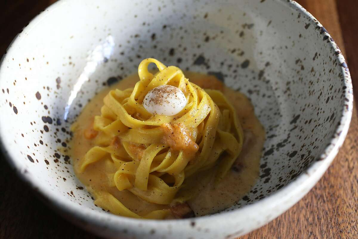 Smoked fettuccini sea urchin, smoked bacon and soft quail egg made at SPQR on Friday, Oct. 26, 2018, in San Francisco, Calif.