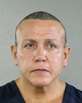 File- In this Aug. 30, 2015, file photo released by the Broward County Sheriff's office, Cesar Sayoc is seen in a booking photo, in Miami. Sayoc will not seek immediate release on bail and agreed Friday, Nov. 2, 2018, to be transferred from Miami to New York to face charges of sending explosive devices to prominent Democrats, critics of President Donald Trump and media outlets. (Broward County Sheriff's Office via AP, File)