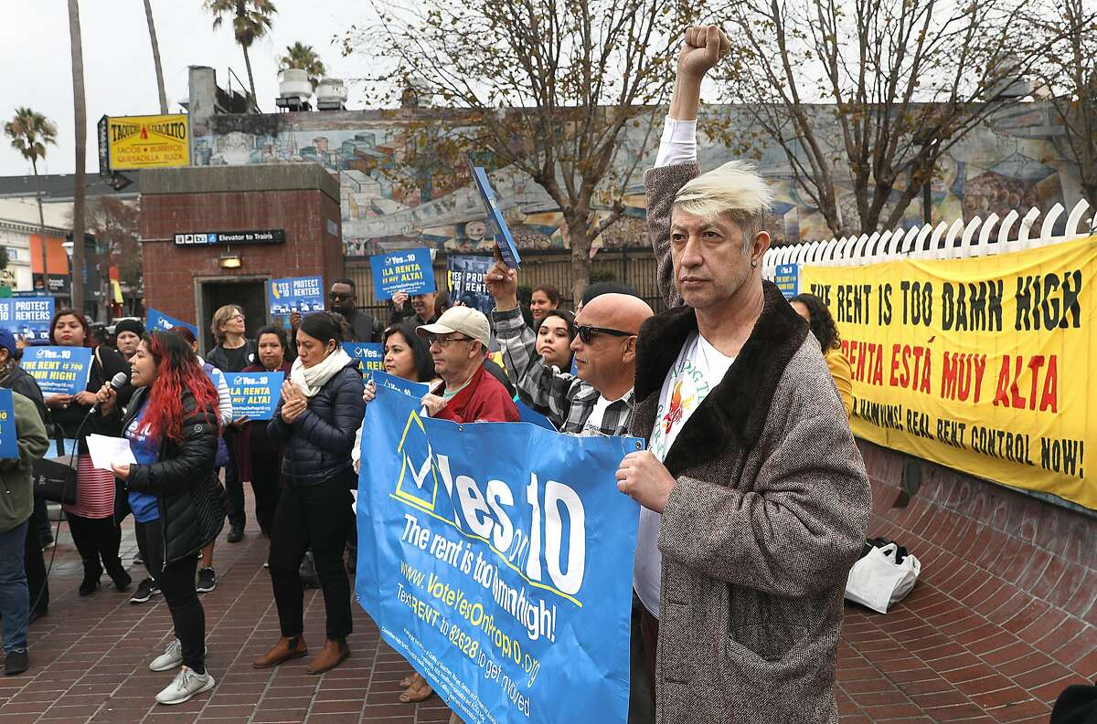 Supporters of proposition 10 rally at the 24th St. Bart station on Monday, Oct. 22, 2018, in San Francisco, Calif.
