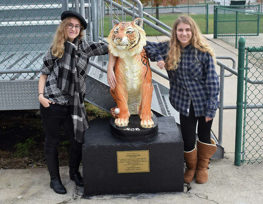 Edwardsville High School seniors Kia Smidt, left, and Grace Becker stand next to the tiger statue they painted last school year. The statue is near the south end zone of the football field. Photo: Matt Kamp/Intelligencer