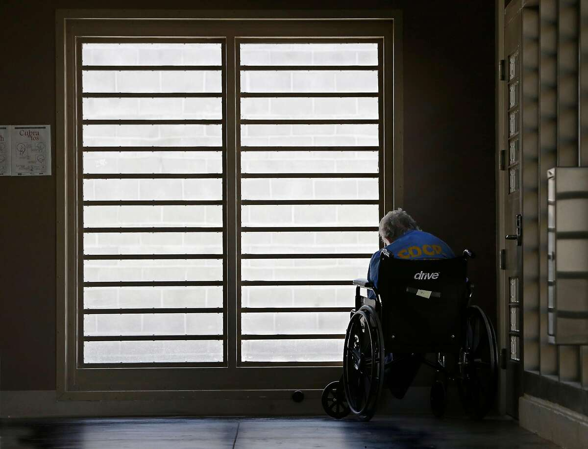 In this July 24, 2014 file photo, an inmate sits by a window at the mental health unit at the California Department of Corrections and Rehabilitation's Stockton Health Facility in Stockton, Calif. In an agreement filed in U.S. District Court in Sacramento, Friday, Aug. 29, state corrections official have agreed to shift mentally ill inmates into specialized housing units instead of placing them in the same isolation units as are used for other inmates, Friday, Aug. 29.(AP Photo/Rich Pedroncelli, file)