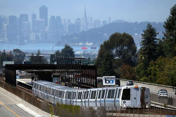 OAKLAND, CA - AUGUST 02: A Bay Area Rapid Transit (BART) train pulls away from the Rockridge station on August 2, 2013 in Oakland, California. San Francisco Bay Area commuters are bracing for the possibility of a BART strike as a 30-day contract extension is set to expire on August 4 at midnight. Unions representing BART workers announced a 72-hour notice of intent to strike yesterday as BART management and union officials continue to negotiate a new contract. An estimated 400,000 people ride BART each day. (Photo by Justin Sullivan/Getty Images)