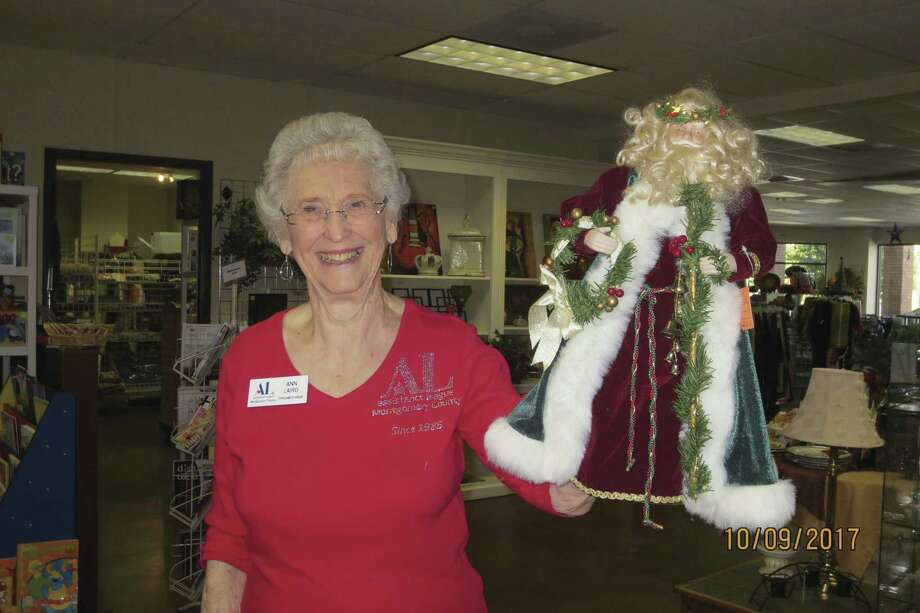Assistance League member Ann Laird preparing merchandise for the Christmas preview on Nov. 12.