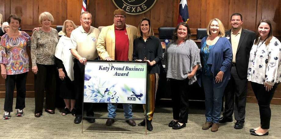 """Colburn and Angie McClelland, owners of Willy Burger and Crown Pizza in Tiger Square Plaza, received the Oct. 22 Katy Proud Business Award from Keep Katy Beautiful. From left areSharon Rhoads, Kay Callender andJamie Wolman, KKB members; Katy Mayor Chuck Brawner; the McClellands; Cynthia Madison and Jennifer Stence, KKB members; Councilmember Chris Harris and Jess Washburn, affiliate coordinator for Keep Katy Beautiful. Willie Burger opened in 2017 and Crown Pizza opened earlier this year at 6191 Highway Blvd. Spence said, in part, """"The two businesses have improved the appearance of Tiger Square shopping center and have initiated obvious revitalization of this prominent area of Highway 90 and 1463."""" Photo: City Of Katy / City Of Katy"""