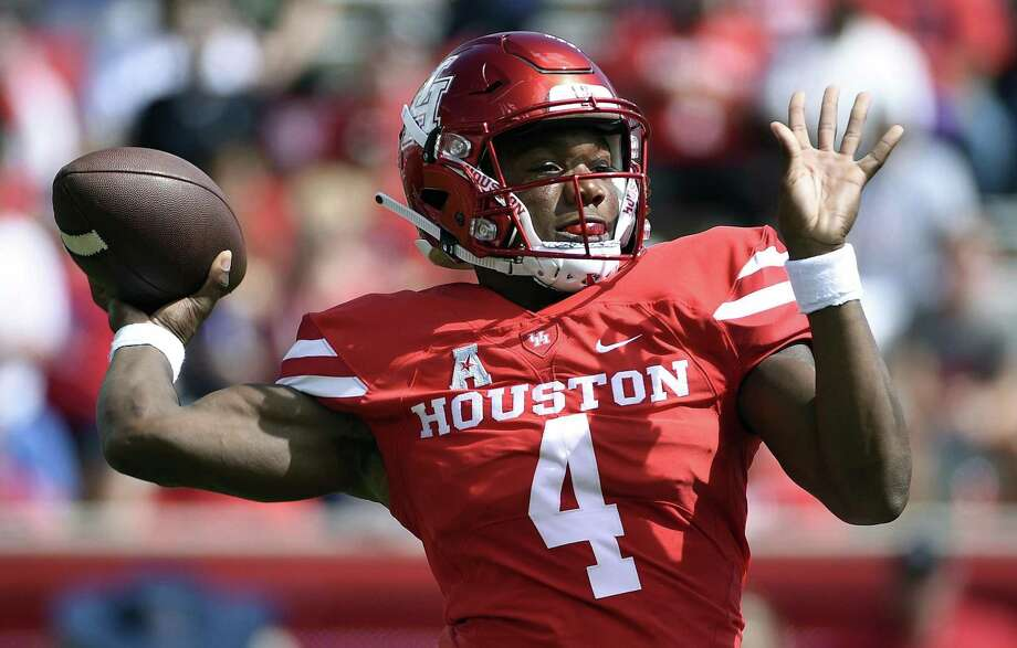 FILE - In this Sept. 8, 2018, file photo, Houston quarterback D'Eriq King drops back to pass during the first half of an NCAA college football game against Arizona in Houston. With quarterback D'Eriq King accounting for 39 touchdowns (28 passing, 11 rushing), the Cougars has scored more than 40 points in all eight games this season, a school record and the nation's longest active streak. (AP Photo/Eric Christian Smith, File) Photo: Eric Christian Smith, FRE / Associated Press / Copyright 2018 The Associated Press. All rights reserved.