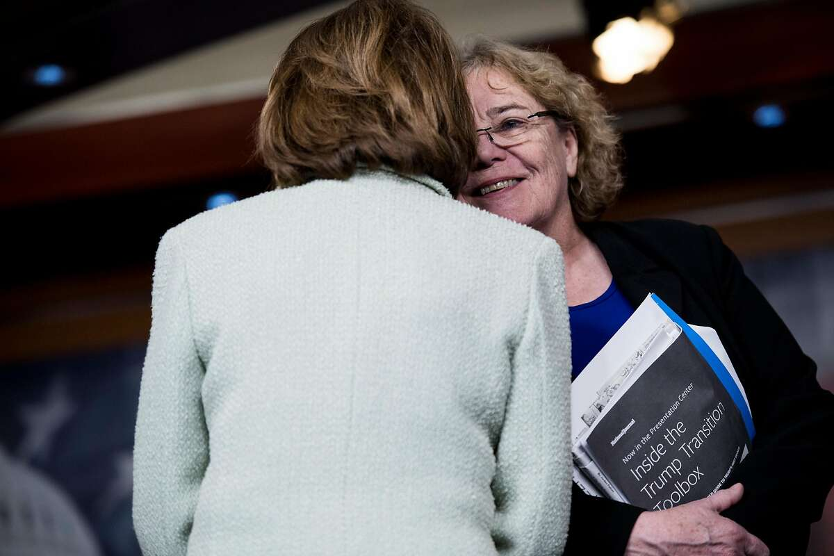 UNITED STATES - FEBRUARY 15: House Minority Leader Nancy Pelosi, D-Calif., and Rep. Zoe Lofgren, D-Calif., talk during the House Democrats' news conference