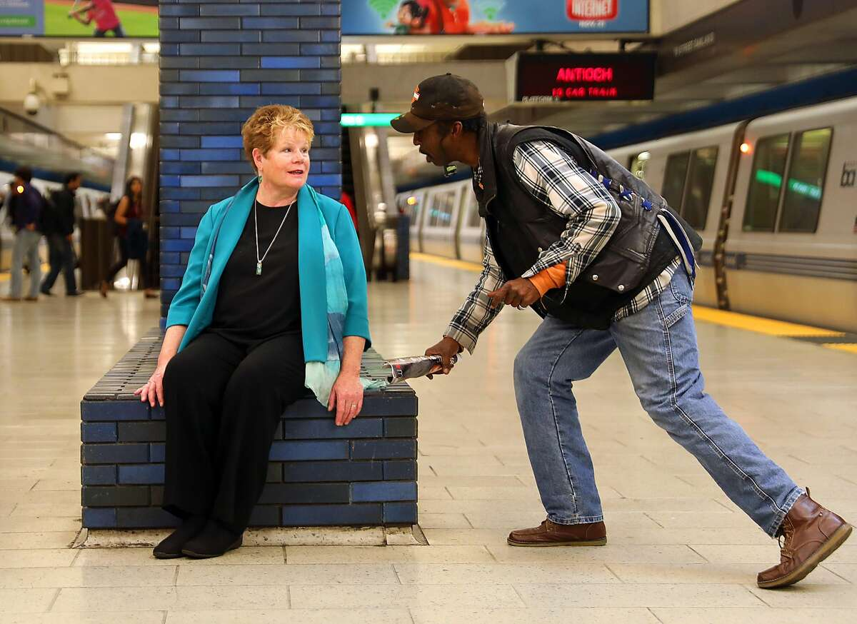 BART General Manager Grace Crunican talks with passenger Gene H. at the 19th Street station on Friday, Nov. 2, 2018, in Oakland, Calif.