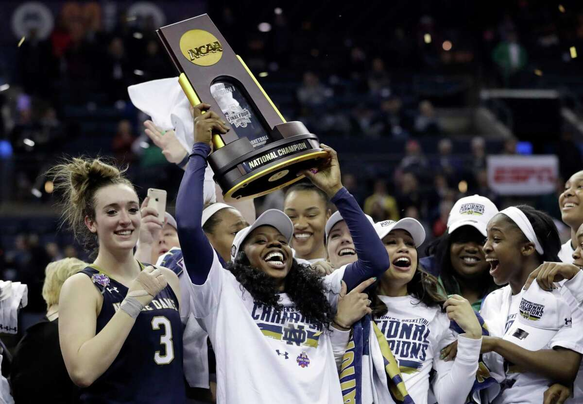 Notre Dame's Arike Ogunbowale holds the championship trophy after defeating Mississippi State for the national title. (AP Photo/Tony Dejak, File)