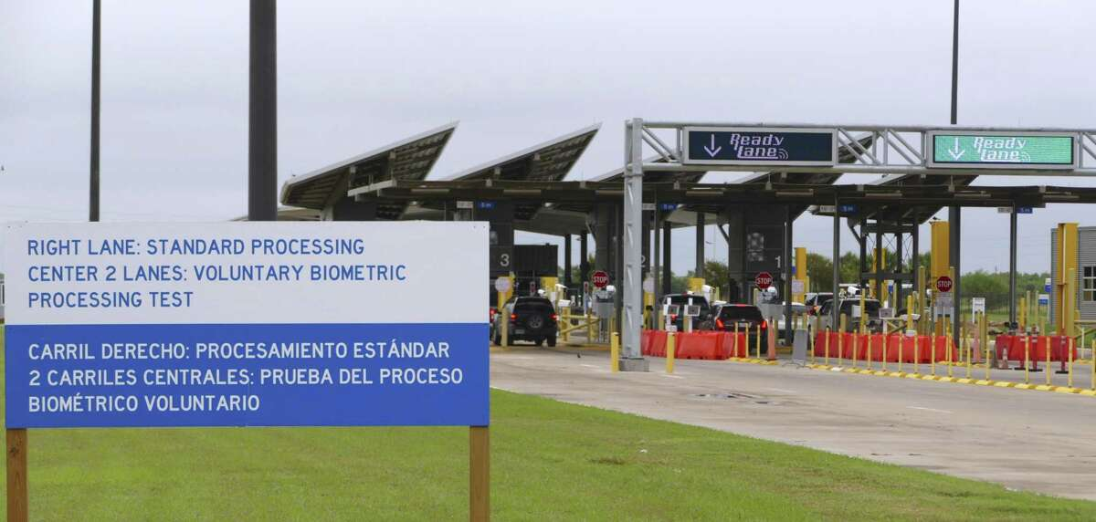 A sign advises drivers entering the U.S. from Mexico that a voluntary biometric test is underway by U.S. Customs and Border Protection at the Anzalduas International Bridge in Mission on Friday, Oct. 19, 2018.