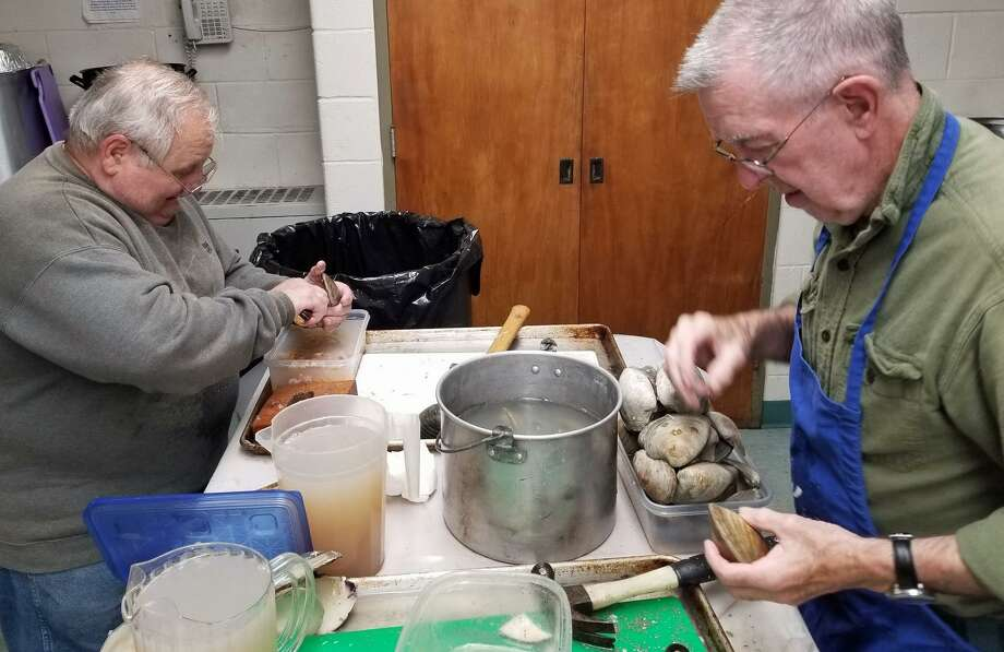 Vin Pepe and Ed Sisson shuck quahogs for Saturday's Clam Chowder Dinner at Cornerstone Community Church, 718 West Ave., Norwalk, from 6 to 8 p.m. The clams were donated by Hillard Bloom Shellfish. Photo: Thane Grauel / Hearst Connecticut Media / Connecticut Post