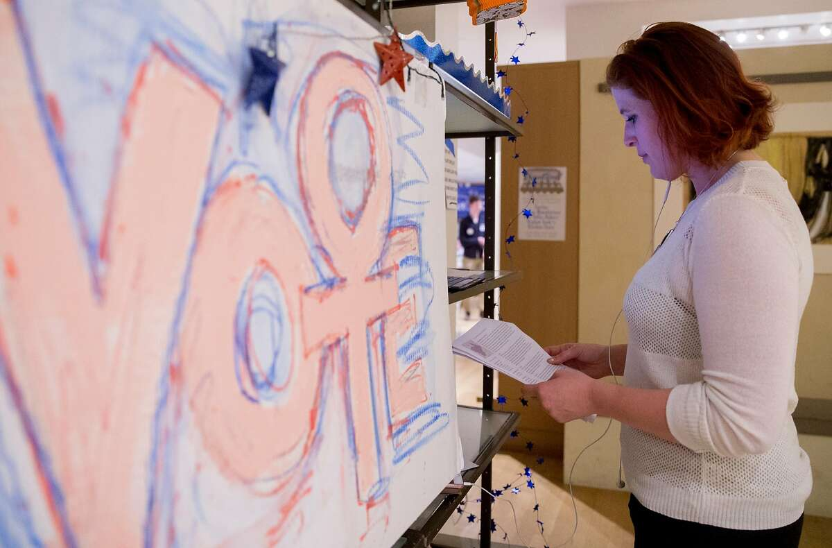 Volunteer Marie Jonas reads over notes before making calls to voters at the Red to Blue campaign office established by House Minority Leader Nancy Pelosi in San Francisco, Calif. Thursday, Nov. 1, 2018.