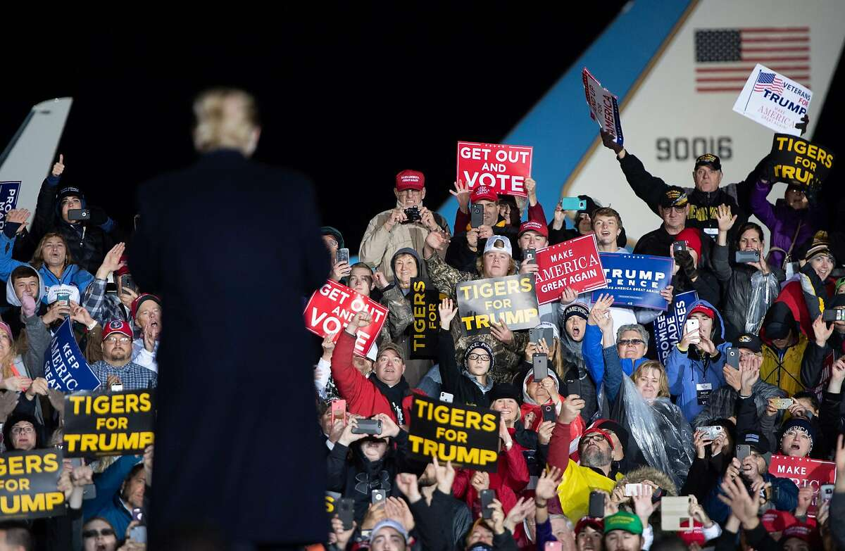 US President Donald Trump faces supporters during a campaign rally at Columbia Regional Airport in Columbia, Missouri, November 1, 2018. (Photo by SAUL LOEB / AFP)SAUL LOEB/AFP/Getty Images