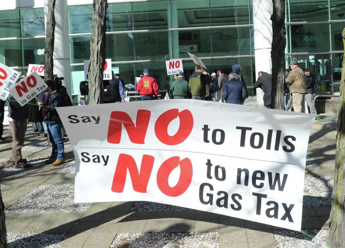 Public protest against tolls, a new gas tax and tire tax, held in front of the Stamford Goverment Center, Stamford, Conn., Saturday, Feb. 17, 2018. Roughly 75 people attended the protest that was accompanied by a caravan of trucks circling the center honking their horns in support of the protest. Gov. Dannel P. Malloy wants legislators to pass measures including electronic tolls, an increase in state gasoline taxes and a new tax on the sale of tires, to pay for Connecticut's transportation system that he says is facing a serious fuding crisis.